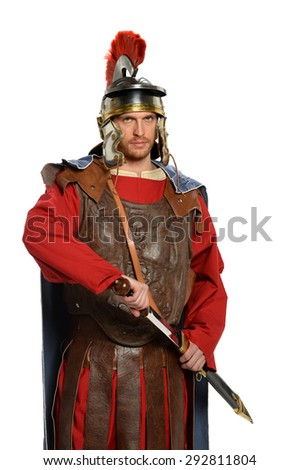 Portrait of Roman soldier with sword isolated over white background - stock photo
