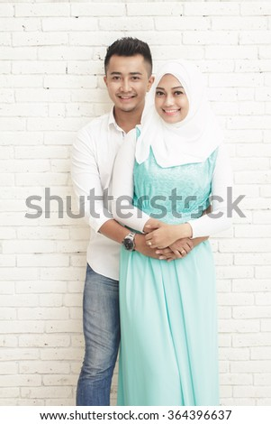 portrait of romantic asian couple on white wall background