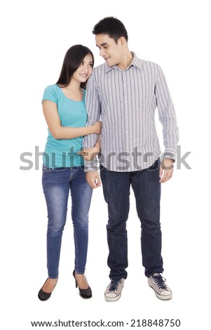 Portrait of romantic couple isolated over white background
