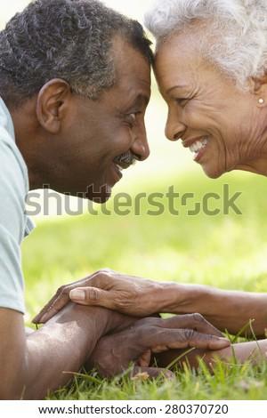 Portrait Of Romantic Senior African American Couple In Park - stock photo