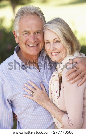 Portrait Of Romantic Senior Couple Relaxing In Countryside