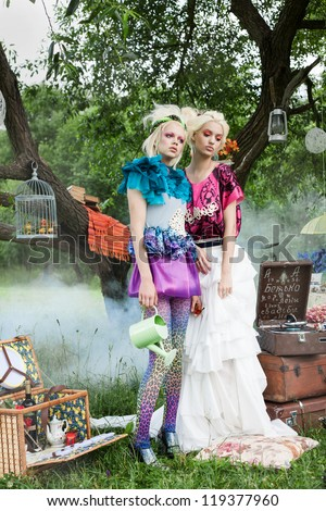 Portrait of romantic women on a picnic in a fairy foggy forest. Outdoors. - stock photo
