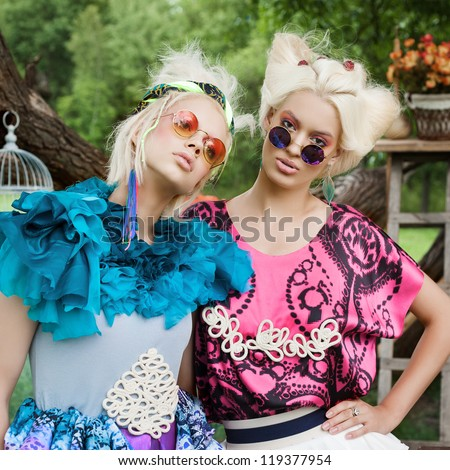 Portrait of romantic women on a picnic in a fairy forest. Outdoors. - stock photo