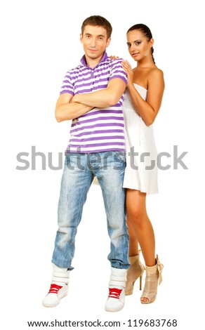 Portrait of romantic young couple hugging each other on white background - stock photo