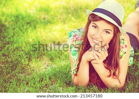 Portrait of romantic young woman with beautiful smile outdoors. Summer day. - stock photo