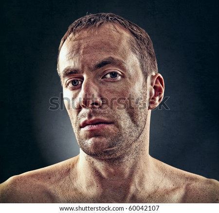 portrait of rough face  man over dark background - stock photo