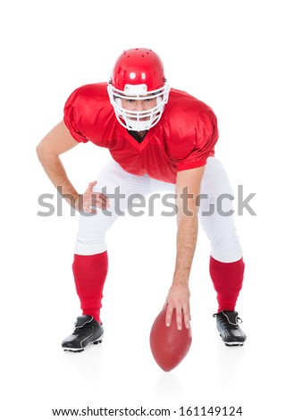 Portrait Of Rugby Player In Ready Position On White Background
