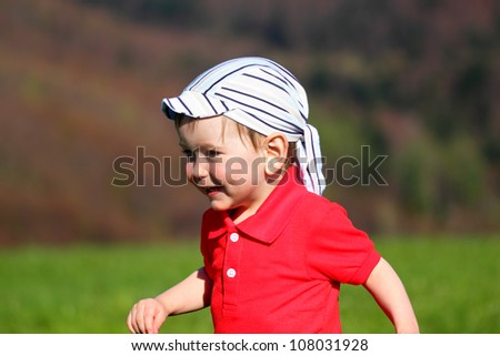 Portrait of Running baby at nature background - stock photo