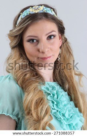 Portrait of russian lady in blue, close up view