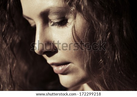 Portrait of sad beautiful woman looking down - stock photo