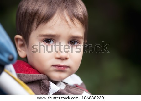 Portrait of sad boy - stock photo