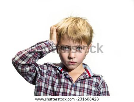 Portrait of sad boy on a white background - stock photo