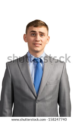 Portrait of sad businessman looking into the camera, isolated on white background