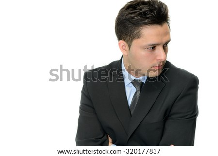 Portrait of sad businessman looking to the side