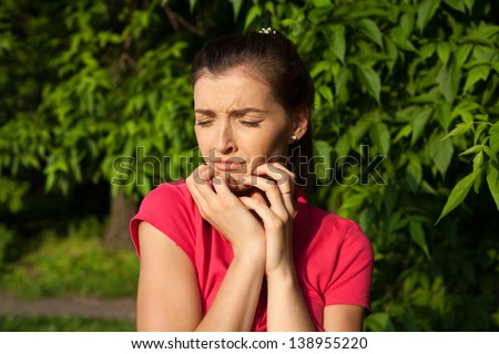 Portrait of sad crying girl at the park - stock photo