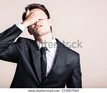 Portrait of sad, depressed businessman - stock photo