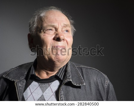 Portrait of sad elderly man - stock photo