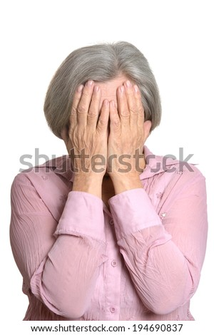 Portrait of sad elderly woman on a white background