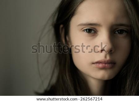 Portrait of sad girl close-up - stock photo