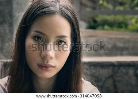 Portrait of sad girl vintage tone - stock photo