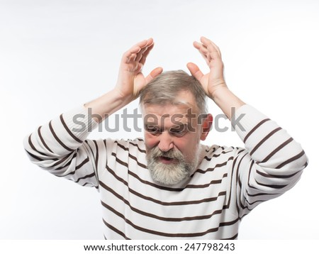 portrait of sad grandfather holding his head hands