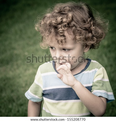 Portrait of sad little boy - stock photo