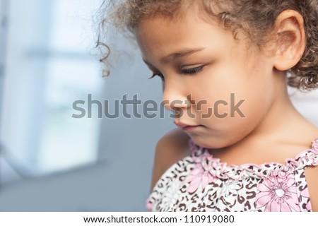 Portrait of sad little girl - stock photo
