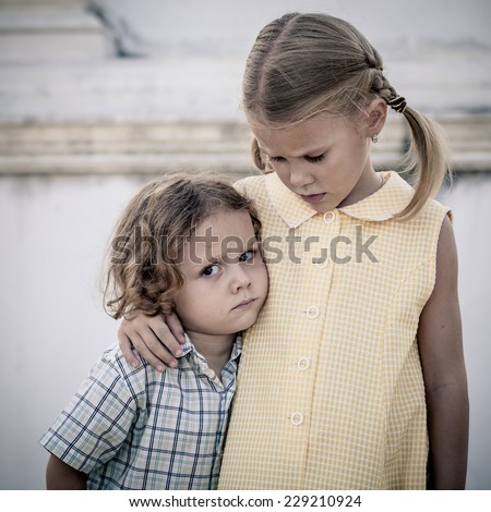 Portrait of sad little girl and boy at the day time - stock photo