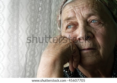 Portrait of sad lonely pensive old senior woman - stock photo