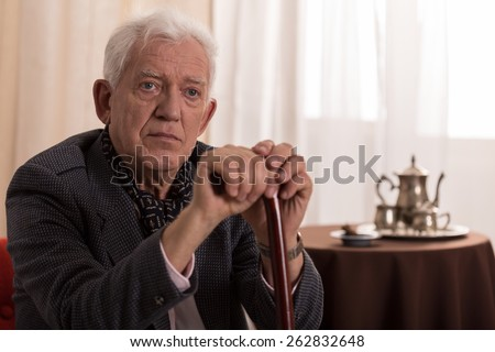 Portrait of sad old businessman suffering from loneliness - stock photo