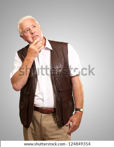 Portrait Of Sad Old Man On Gray Background - stock photo