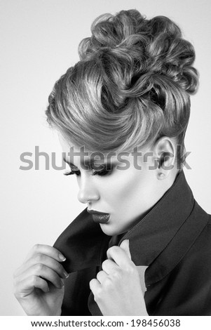 Portrait of sad pretty woman sets the collar straight (in black and white) - stock photo