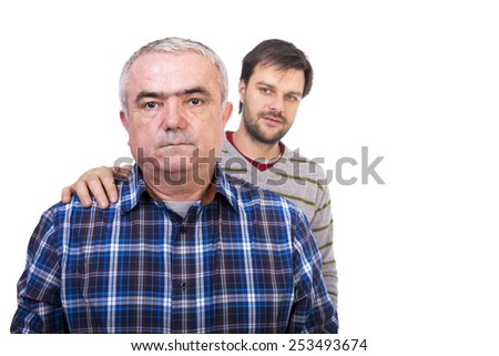 Portrait of sad senior man being comforted by his son against white  - stock photo