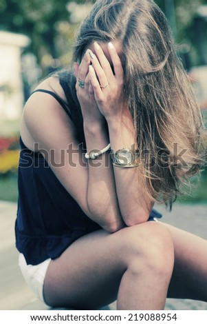 portrait of sad teenage girl - stock photo