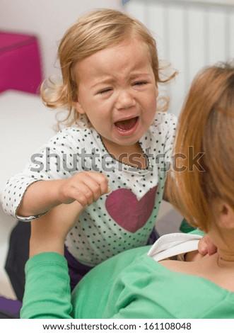 Portrait of sad unhappy crying little girl. - stock photo