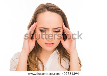 Portrait of sad woman with strong pain in her head - stock photo