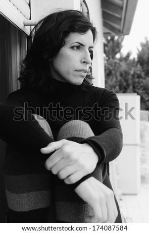 Portrait of sad 35 years old woman - stock photo