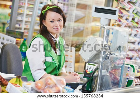Portrait of Sales assistant or cashdesk worker in supermarket store - stock photo