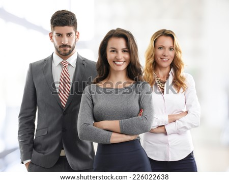 Portrait of sales team standing at office.  - stock photo