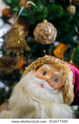 Portrait of Santa Claus doll, Christmas tree background