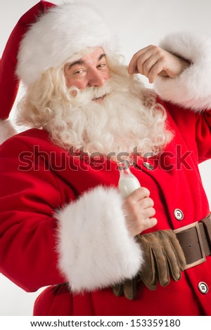 Portrait of Santa Claus Drinking milk from glass bottle. Greeting card background