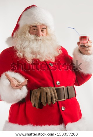 Portrait of Santa Claus Drinking milk from glass. Greeting card background