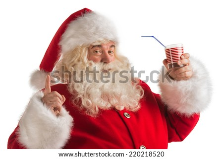 Portrait of Santa Claus Drinking milk from glass. Greeting card background - stock photo