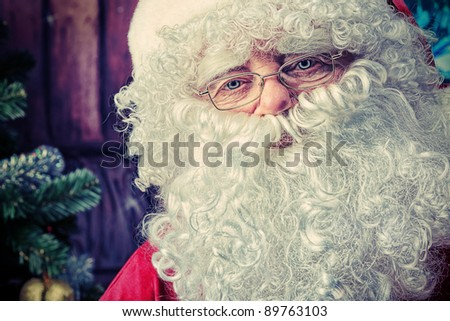 Portrait of Santa Claus over Christmas background.