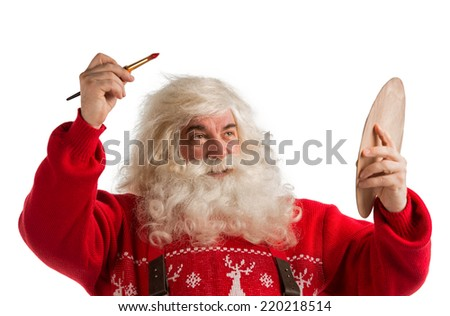 Portrait of Santa Claus painting with brush and palette isolated on white background