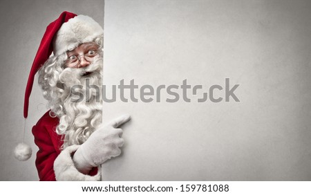portrait of Santa Claus showing billboard - stock photo