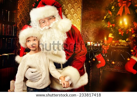 Portrait of Santa Claus with a boy standing at home decorated for Christmas. Christmas scene.  - stock photo
