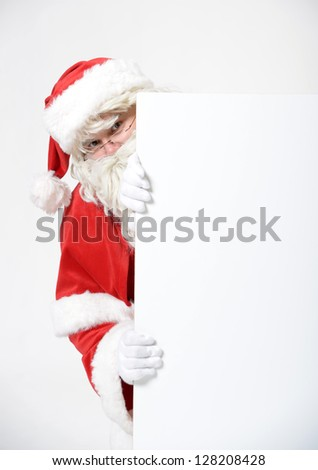 portrait of santa clause behind advertising board - stock photo