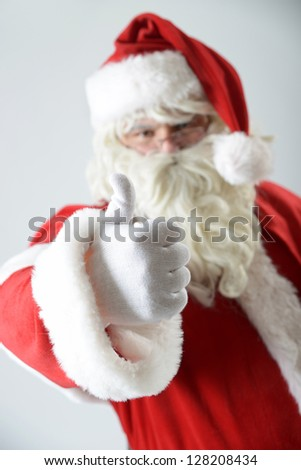 portrait of santa clause with thumb up - stock photo