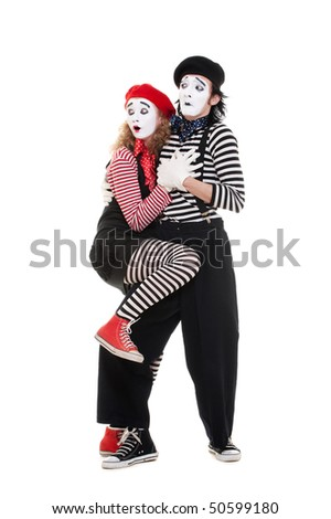 portrait of scared couple of mimes. isolated on white - stock photo
